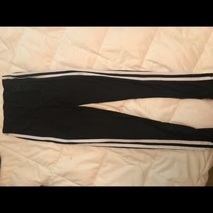 Pants - black leggings with 3 white stripes.
